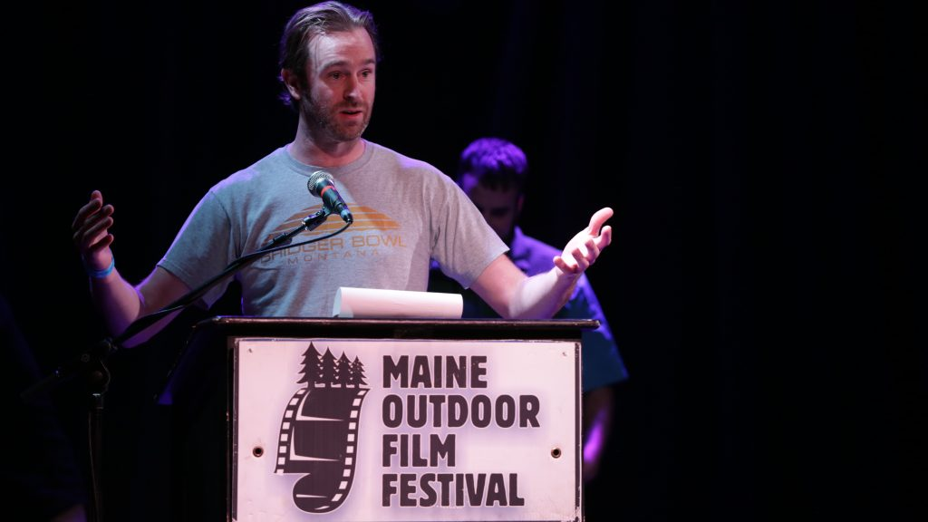Joel Osgood, director of 1000 FEET & BELOW, accepts the award for 2016 BEST FILM, BEST MAINE FILM and BEST SHORT FEATURE at the 2016 MOFF Awards Show on November 4, 2016 at Port City Music Hall in Portland, Maine. Photo by Nick Bowie.